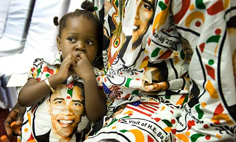 A Ghanaian girl and her father get ready to welcome Barack Obama in Accra in 2009