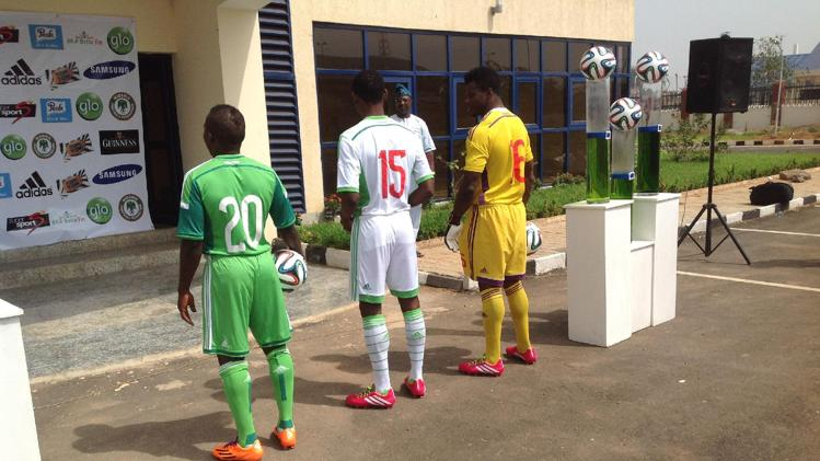 In this photo made available by the Nigeria Football Federation, soccer players display soccer jerseys Abuja, Nigeria, Thursday, Feb. 27, 2014, that will be worn during the 2014 World cup in Brazil. Sportswear giant Adidas said it designed the new kit to reflect