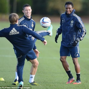 All smiles: Mikel was back with his team-mates in training amid the race row