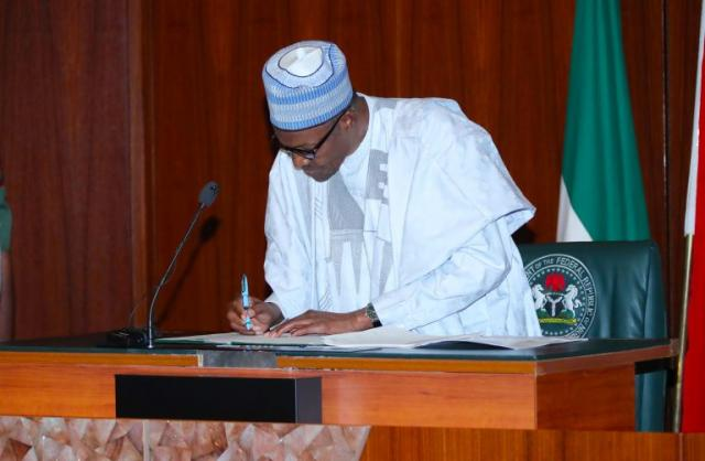 Buhari signs minimum wage bill into law