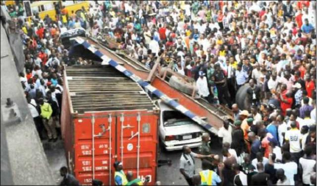 Truck laden with container falls, claims 3 lives in Lagos